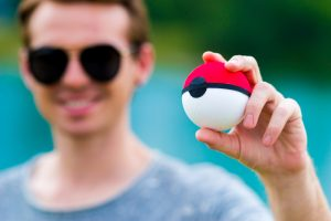 A loyal Pokemon fan holding a Pokeball